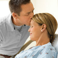Husband kisses pregnant wife image